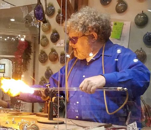 Glassblowing Asheville - Jason blowing glass at Mountain Made gallery